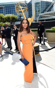 Kerry Washington dazzled at the Emmys in an orange Prada strapless gown with bedazzled seams and a short black underlay peeking through the thigh-high slit.