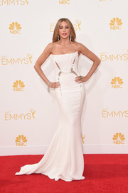 Sofia Vergara dressed up her famous curves in a glamorous white strapless gown featuring geometric silver accents for the Emmys.
