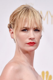 January Jones attended the Emmys wearing an edgy twisted updo with eye-grazing bangs.