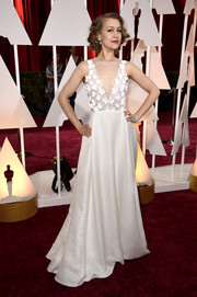 Joanna Newsom looked darling at the Oscars in a white Honor gown with a flower-appliqued, sheer-panel bodice.