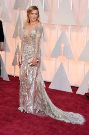 Katie Cassidy went for seductive glamour at the Oscars in a sheer, sequined gown by Julien Macdonald.