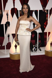 Kerry Washington opted for a simple and classic champagne peplum strapless gown by Miu Miu when she attended the Oscars.