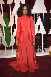 Solange Knowles completed her dramatic Christian Siriano ensemble with a pair of red wide-leg pants.