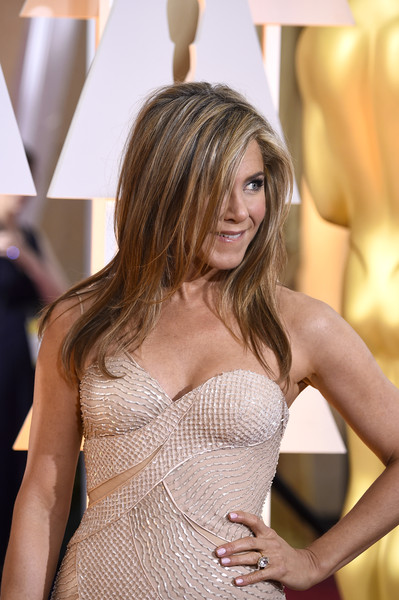 More Pics of Jennifer Aniston Layered Cut (28 of 117) - Jennifer Aniston Lookbook - StyleBistro [hair,clothing,shoulder,dress,hairstyle,beauty,blond,fashion,long hair,cocktail dress,hollywood highland center,california,87th annual academy awards,arrivals,jennifer aniston]