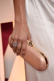 Zendaya Coleman attended the 2015 Oscars carrying a chic blush python clutch.