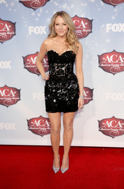 Jewel looked ravishing in a beaded, strapless black corset dress by Jovani at the American Country Awards.