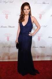 Debra Messing looked ravishing in a low-cut blue halter gown during the Angel Ball.