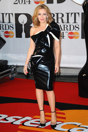 Kylie Minogue vamped it up at the Brit Awards in a black latex one-shoulder dress by William Wilde, featuring two massive bows.