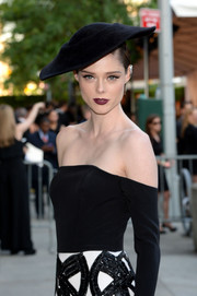 Coco Rocha teamed a black Heather Huey hat with an off-the-shoulder dress for the CFDA Fashion Awards.