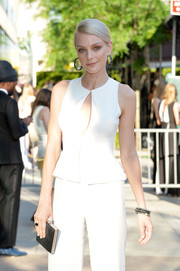 Jessica Stam complemented her white jumpsuit with an elegant black hard-case clutch during the CFDA Fashion Awards.