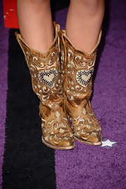 Janelle Arthur showed off her country roots with this pair of tan heart-embellished boots.