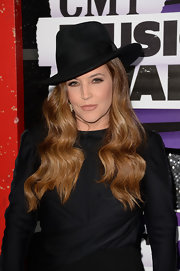Lisa Marie looked sleek and cool in this wide-brimmed fedora.
