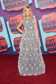 Beth Behrs went for a sweet, youthful vibe with this flower-appliqued gown by Erin Fetherston during the CMT Music Awards.