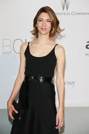Sofia Coppola styled her LBD with an oversized patent leather belt by Louis Vuitton for the amfAR Cinema Against AIDS Gala.