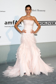 Izabel Goulart went all out with the frills in this blush-colored Emilio Pucci strapless gown, featuring a tiered skirt and feather accents, during the Cinema Against AIDS Gala.