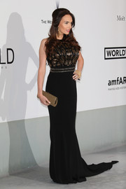 Tamara Ecclestone paired her dress with a classic gold tube clutch.