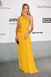 Rosie Huntington-Whiteley brought a bright pop of color to the Cinema Against AIDS Gala with this goddess-worthy yellow one-shoulder gown by Emilio Pucci.