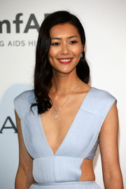 Liu Wen complemented her decollete gown with a beautiful diamond drop necklace during the Cinema Against AIDS Gala.