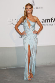 Heidi Klum looked provocative in an embellished blue Atelier Versace one-shoulder gown with cleavage-baring keyhole detail and a crotch-grazing slit during the Cinema Against AIDS Gala.