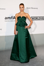 Natasha Poly looked regal in an emerald-green strapless peplum gown by Marni at the Cinema Against AIDS Gala.
