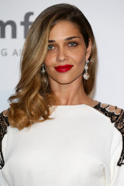 Ana Beatriz Barros' bold red lipstick looked striking against her monochrome outfit.