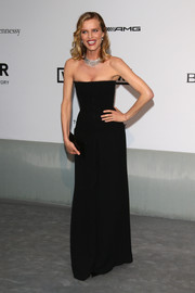 Eva Herzigova went for simple sophistication in a strapless black jumpsuit during the Cinema Against AIDS Gala.
