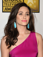 Emmy Rossum's Sutra turquoise earrings provided a beautiful color contrast to her fuchsia dress.