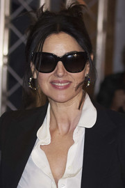 Monica Bellucci finished off her look with chic butterfly sunglasses.