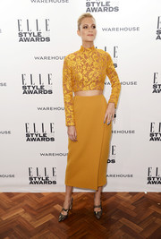 Poppy Delevingne chose a pair of vintage-chic patterned pumps to team with her crop-top and skirt combo.