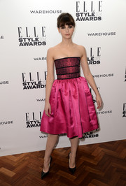 Felicity Jones oozed sweetness at the Elle Style Awards in a strapless pink fit-and-flare dress by Christopher Kane.