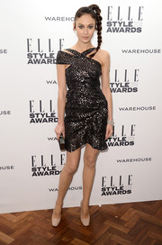 Olga Kurylenko went for modern glamour with this asymmetrical, sequined Isabel Marant mini during the Elle Style Awards.