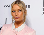 Laura Whitmore sported a simple ponytail with center-parted bangs during the Elle Style Awards.