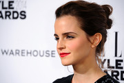 Emma Watson's beauty look totally popped thanks to that rich red lip color.