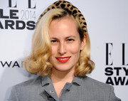 Charlotte Dellal wore a retro-chic side-parted 'do with curly ends during the Elle Style Awards.