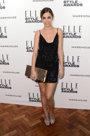 Amber Le Bon topped off her head-turning look with an oversized metallic gold clutch by Jimmy Choo.