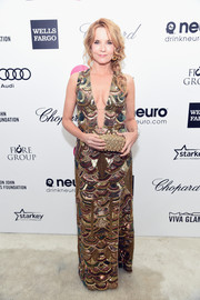 Lea Thompson looked ageless and sexy at Elton John's Oscar-viewing party in a Maricela David deep-V gown rendered entirely in scalloped beading.