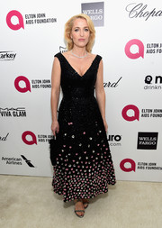 Gillian Anderson's flower-beaded LBD at Elton John's Oscar-viewing party had a charming '50s feel.