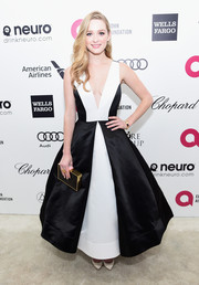Greer Grammer complemented her dress with an elegant black and gold box clutch.