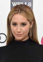 Ashley Tisdale went for simple styling with this loose center-parted 'do during Elton John's Oscar-viewing party.