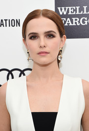 Zoey Deutch pulled her locks back into a loose, center-parted ponytail for Elton John's Oscar-viewing party.
