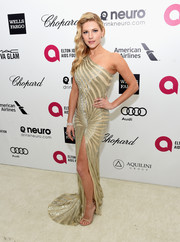 Katheryn Winnick was a shining beauty in a striped gold one-shoulder gown by Naeem Khan during Elton John's Oscar-viewing party.