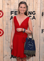 Lauren Bush Lauren looked chic and girly in a low-cut red wrap dress at the Feed USA + Target launch.