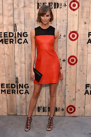 Karlie Kloss looked totally fierce at the Feed USA + Target launch in an orange and black leather dress.