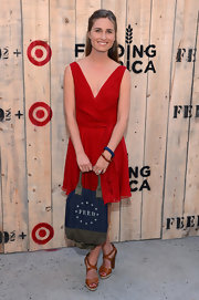 Lauren Bush Lauren complemented her chic red dress with casual tan strappy sandals when she attended the Feed USA + Target launch.