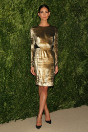 Lily Aldridge looked simply divine in a long-sleeve gold cocktail dress by Veronica Beard during the Fashion Fund finalists celebration.