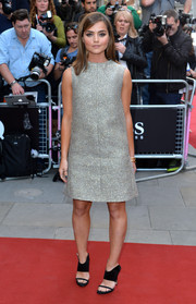 Jenna-Louise Coleman contrasted her retro dress with modern black ankle-cuff sandals.