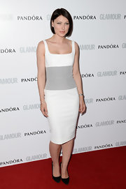 Emma Willis showed off her curves with this sleeveless white frock with a silver embroidered waist.