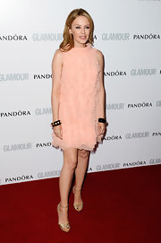 Kylie Minogue's pretty pink dress featured ruffles for a fun and flirty vibe on the red carpet.