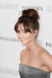Jenna-Louise Coleman piled her brunette tresses on top of her head with a cool and casual twisted bun.