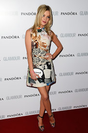 Laura Whitmore's newsprint collage dress gave her a fun and bold statement on the red carpet!